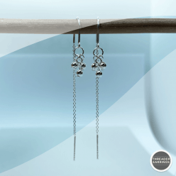 Sterling silver triple ball dangly earrings - hanging view