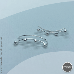 Sterling silver four ball ear climbers - front view