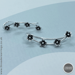 Sterling silver four flower ear climbers - front view
