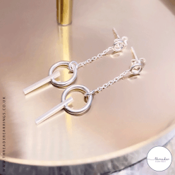 Sterling silver circle and bar earrings - on tray