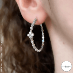 Sterling silver hoop earrings with cubic zirconia and flower
